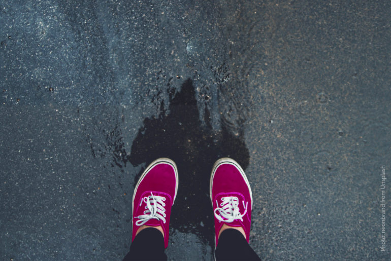 pink shoe over a water hole